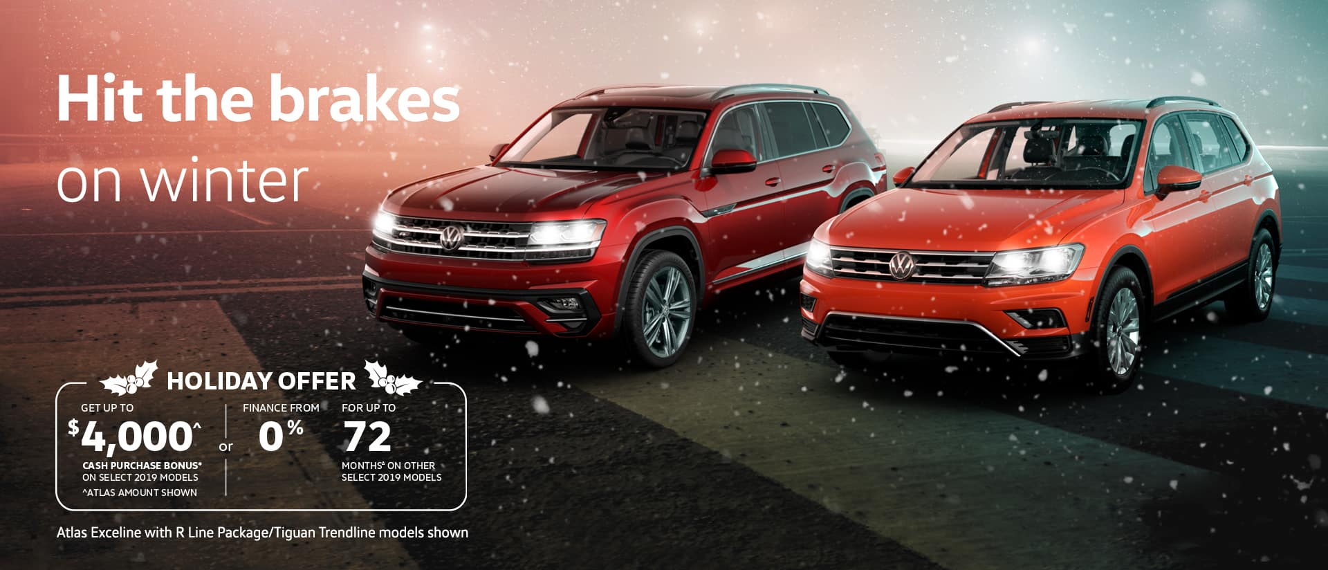 two volkswagen SUVs with snow falling around them