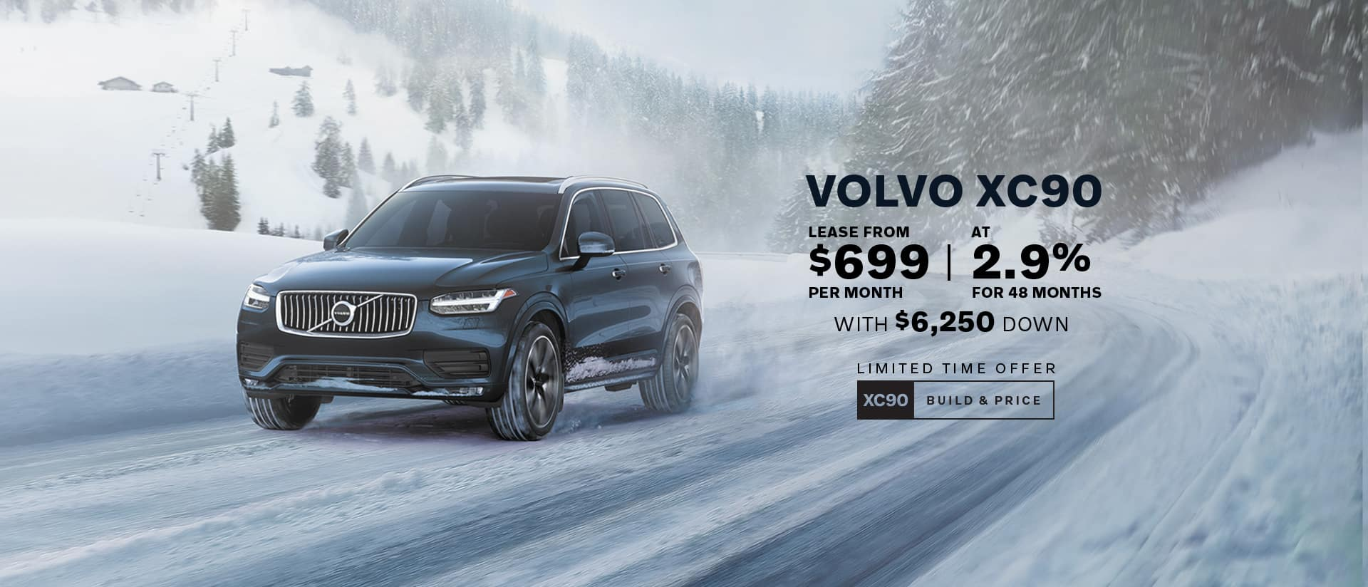 black xc90 driving on a snowy road