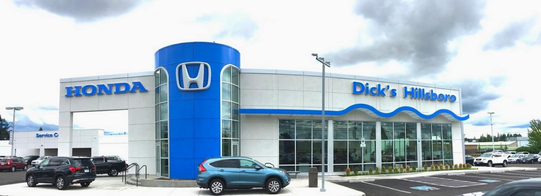 An exterior shot of a Honda dealership