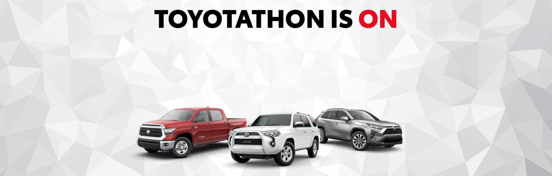 Toyotathon is on slider with a red toyota tundra, white toyota 4runner and grey toyota rav4 lined up side by side