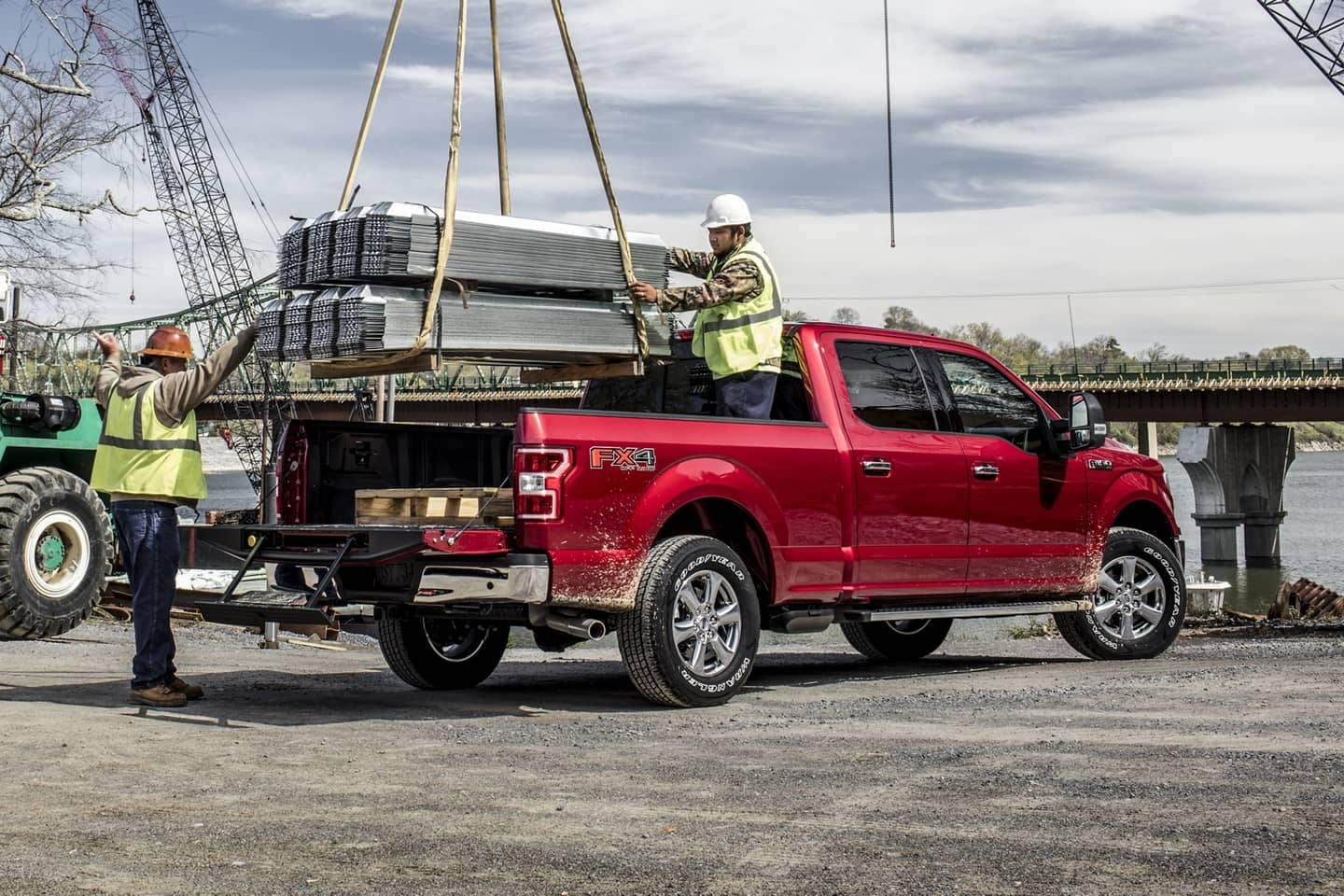 FORD F150 cab being loaded by construction workers