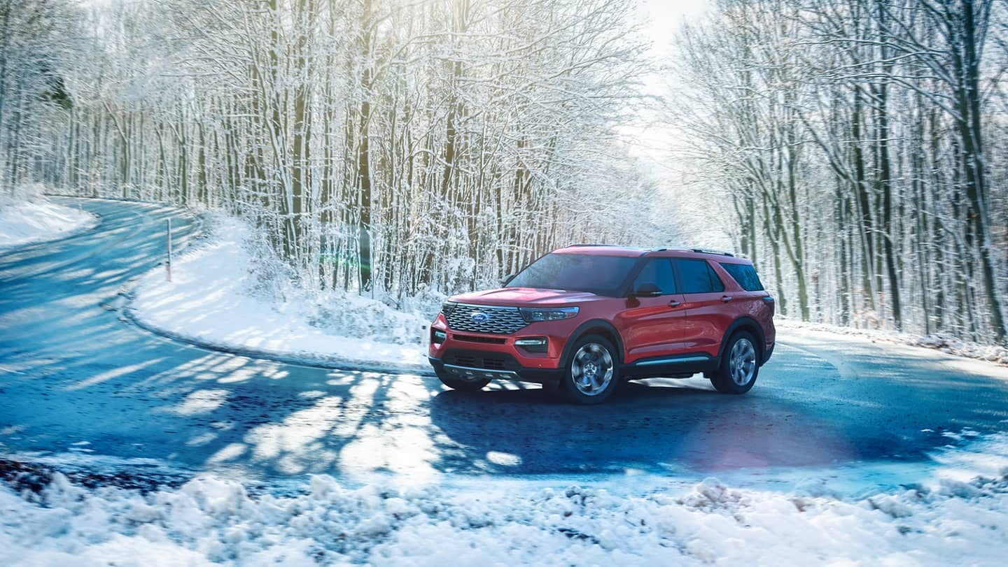 Ford Explorer turns on winding snowy uphill road