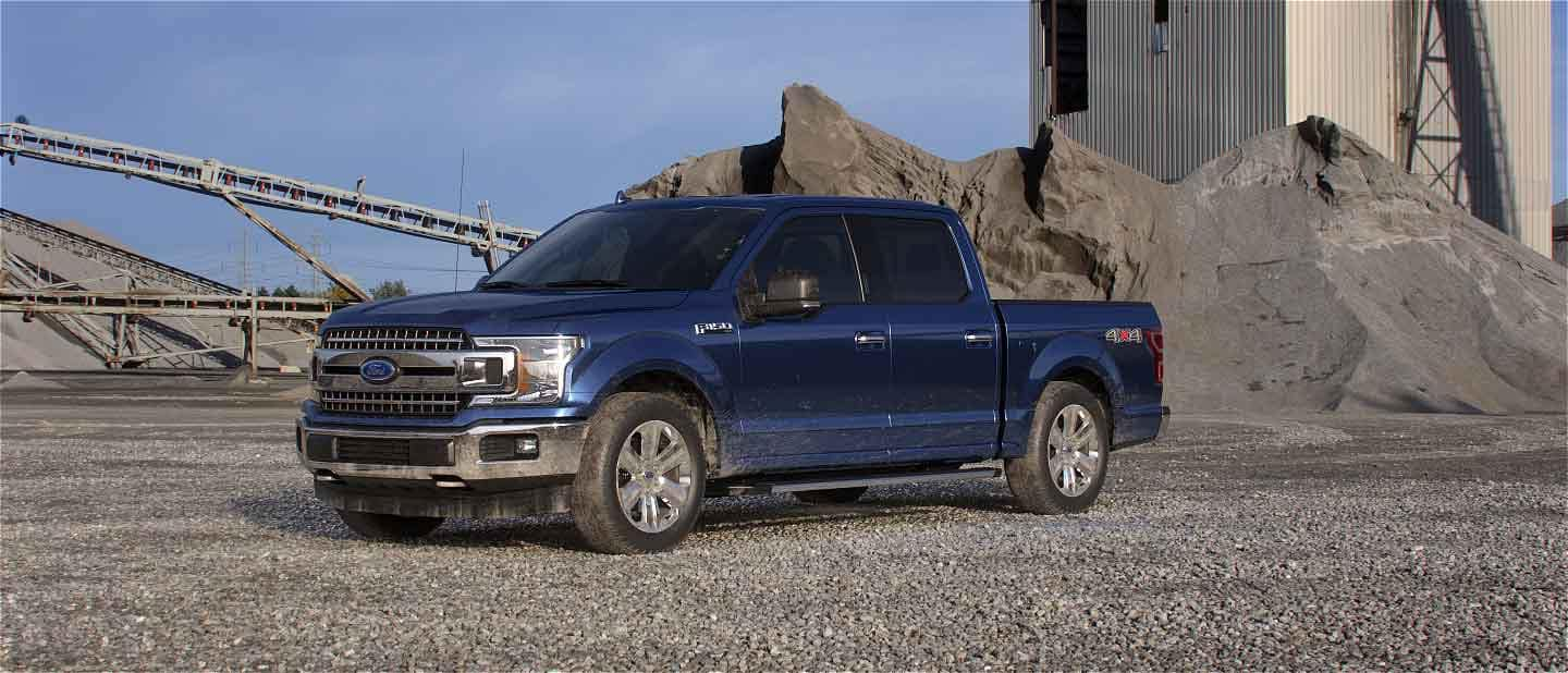 blue Ford F-150 parked at construction site
