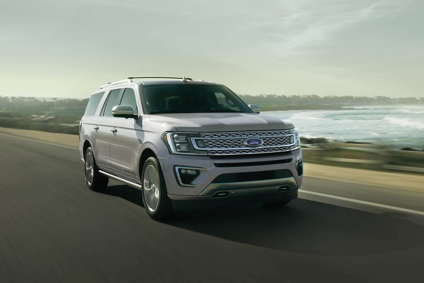 Ford Expedition drives on seashore highway