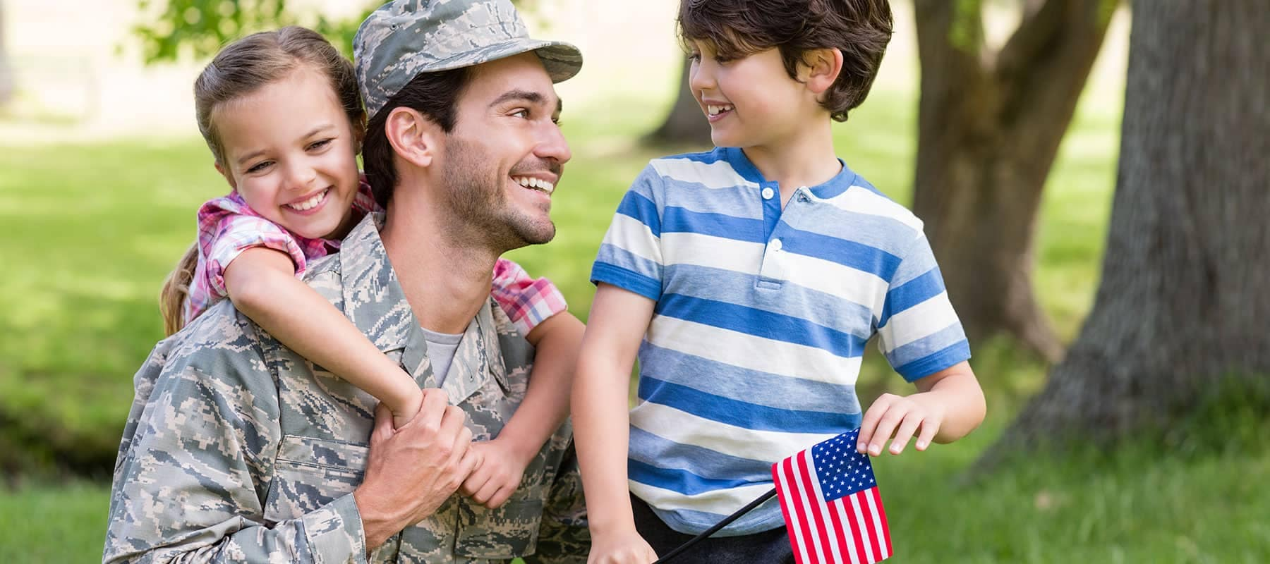 military man receives hug from daughter and smile from son