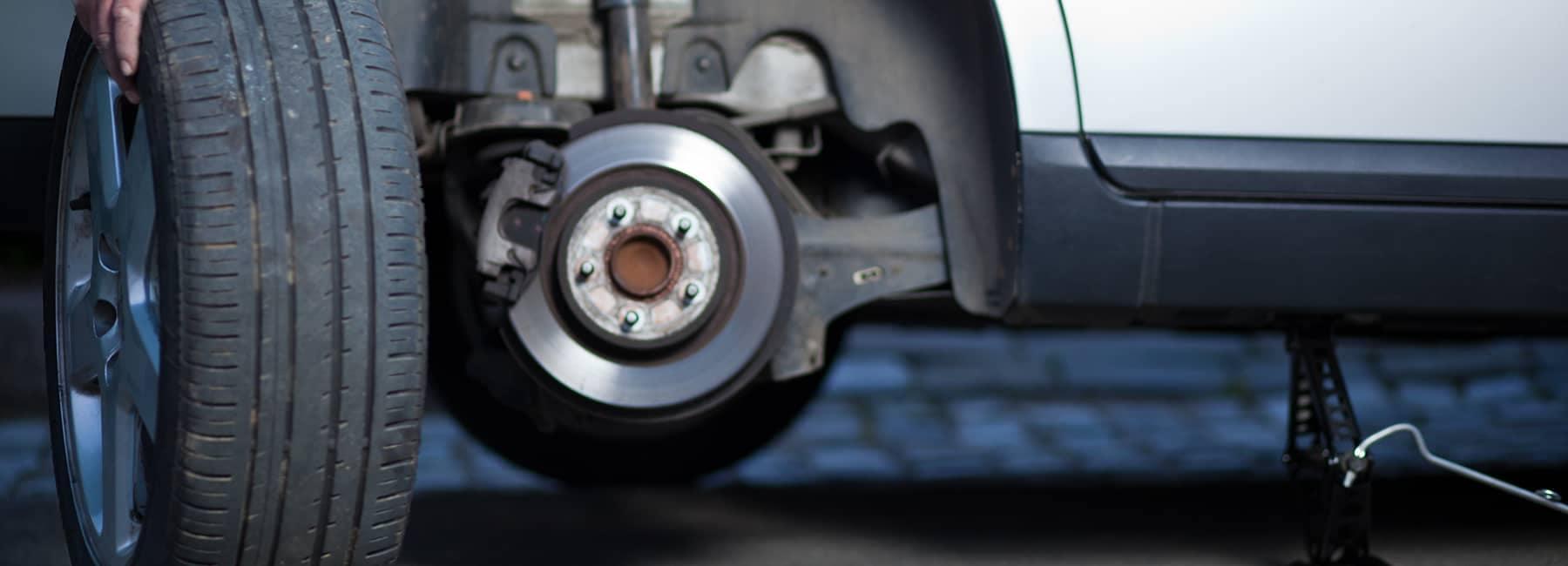removing tire to repair car brakes