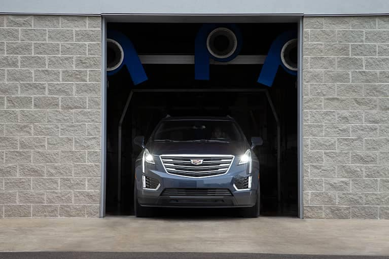 Cadillac coming out of a garage
