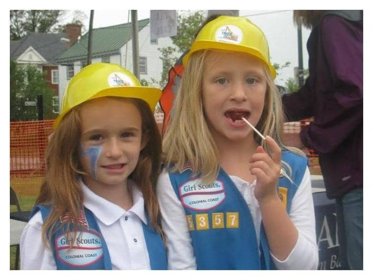 2 Girl scouts wearing hard hats