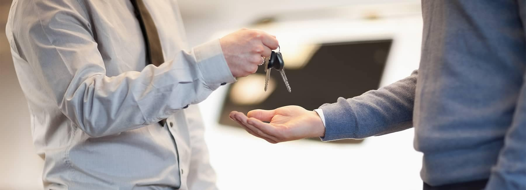 Salesman Handing Car Keys to Man