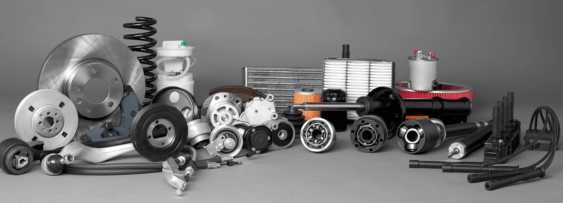 Various Car Parts on Grey Background