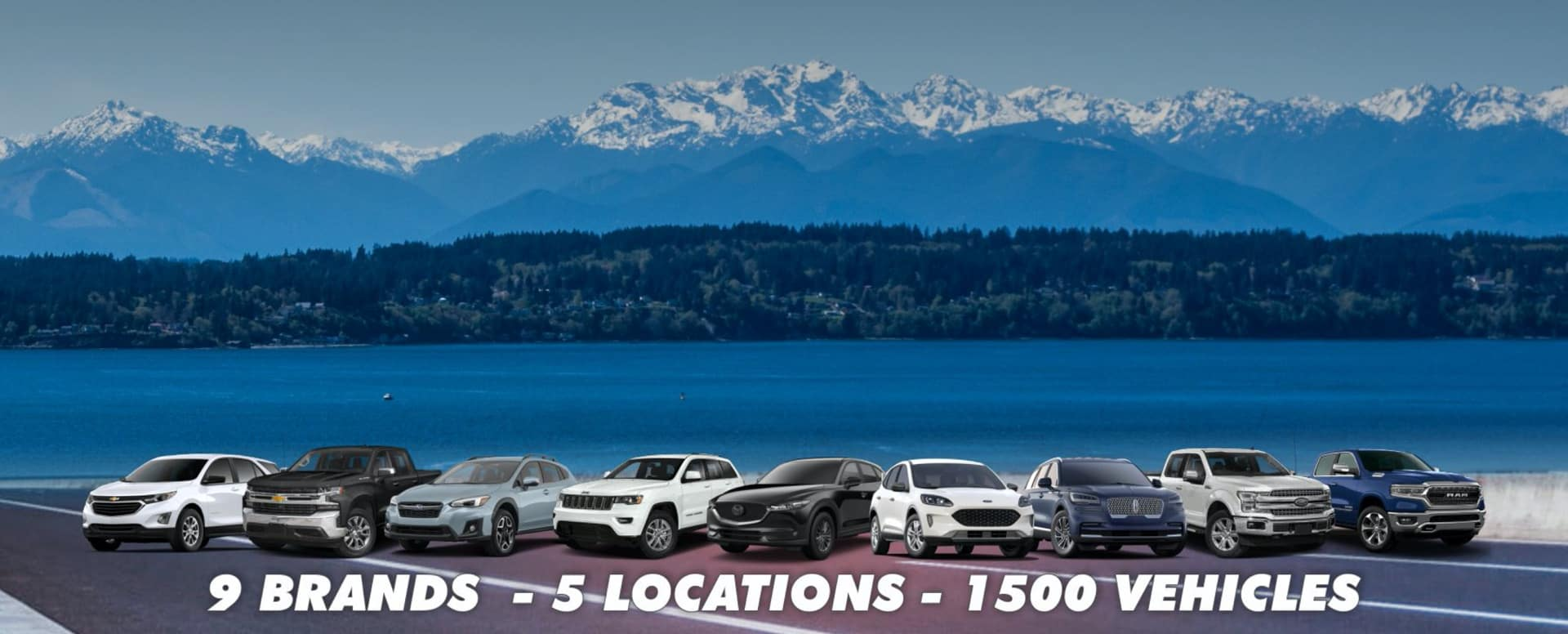Car lineup in front of mountain range