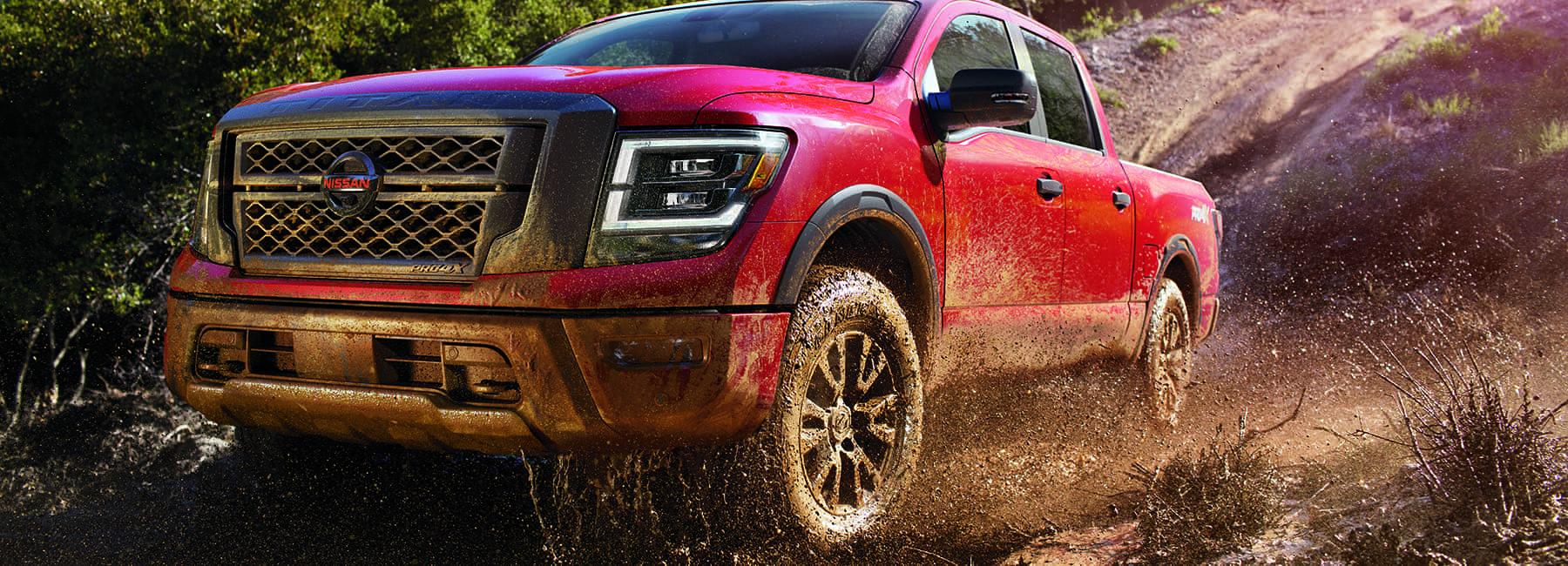 2020-nissan-titan-pro-4x-driving-through-mud