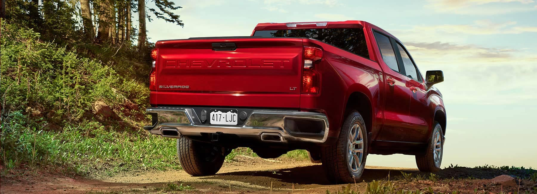 2019 Red Chevrolet Silverado LT Back View Parked on Dirt Road