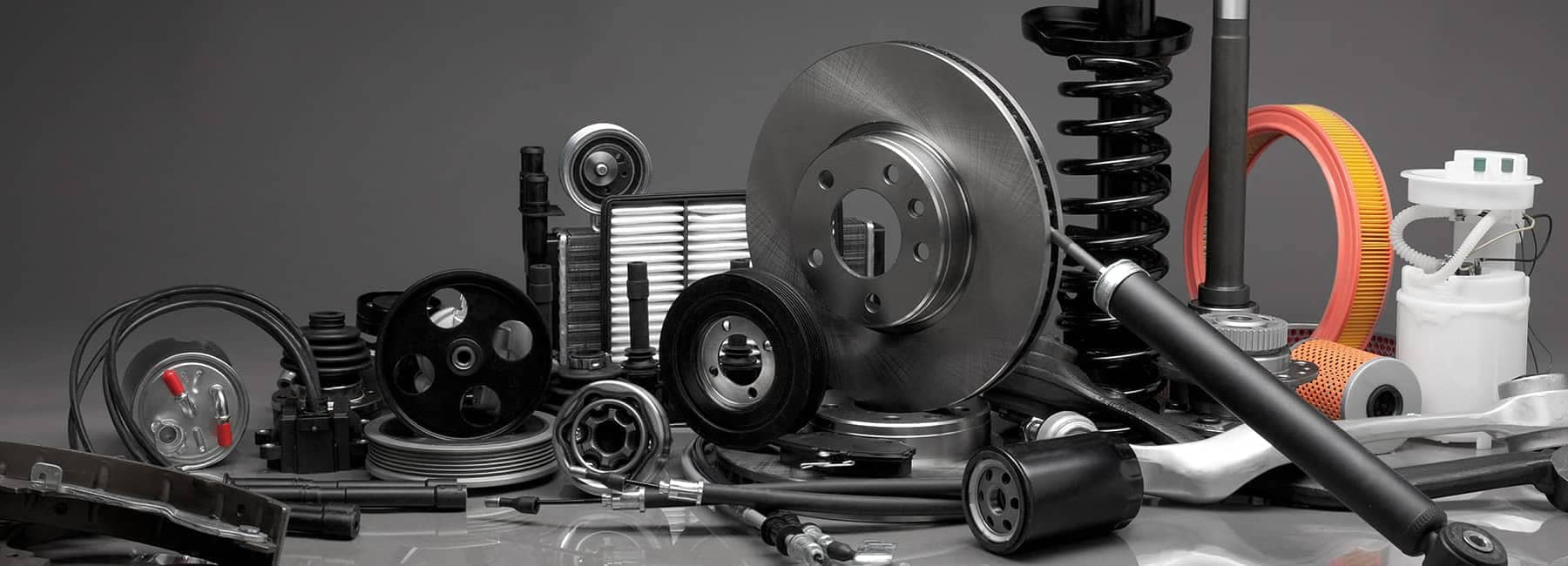 Various Car Parts Arranged on Table