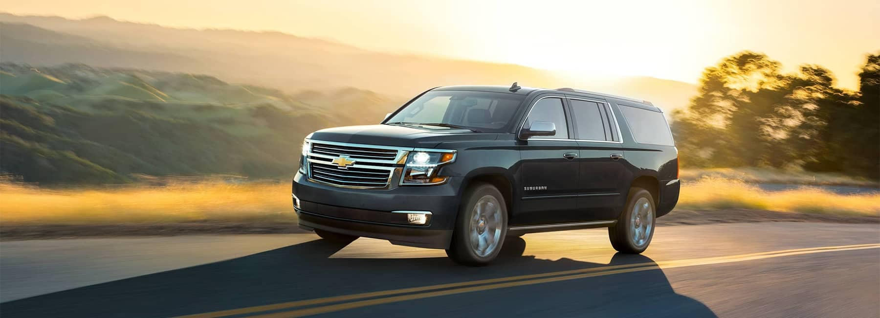 2019 Suburban Driving Down the Road
