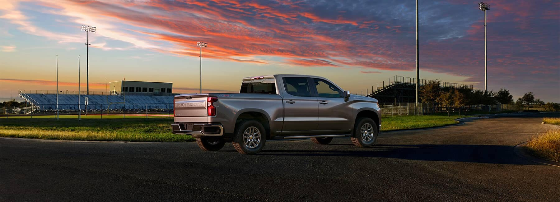 2020 Silverado 4x4 in Satin Steel Metallic at Football Stadium with Sunset