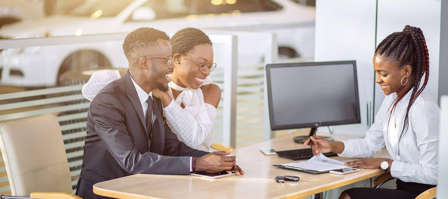 Couple Buying a New Car in Finance Office