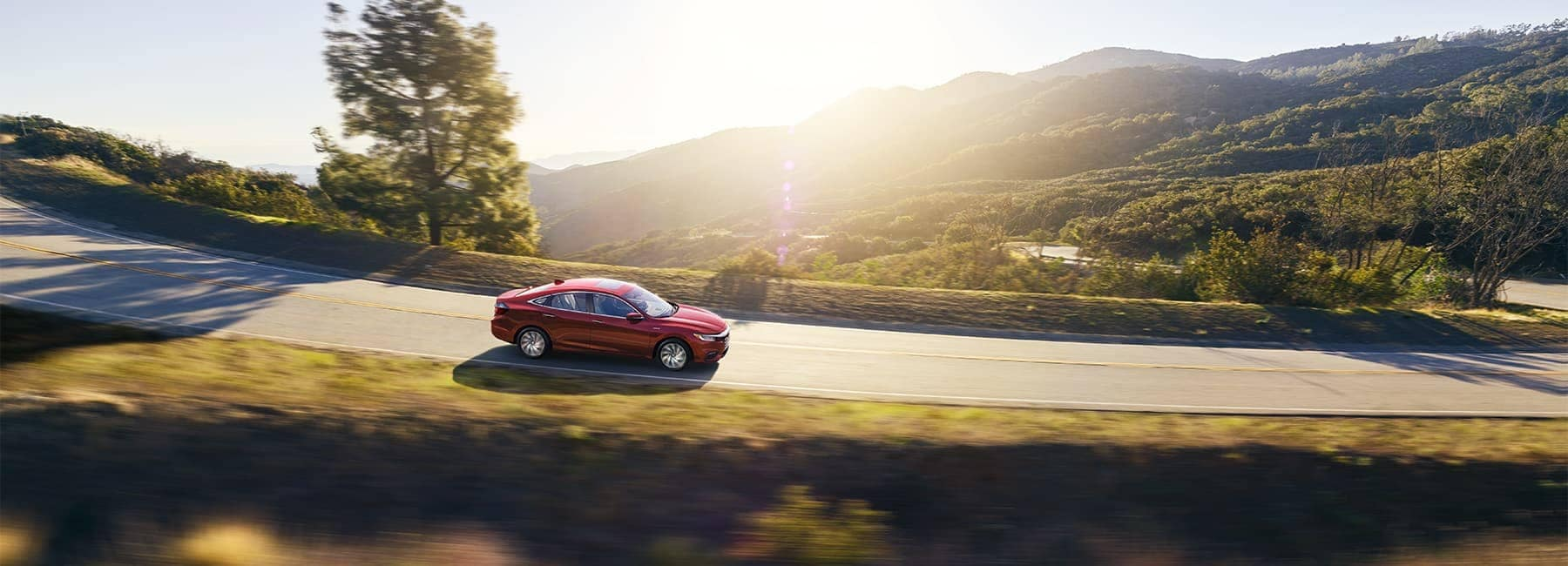 Honda Insight driving through countryside