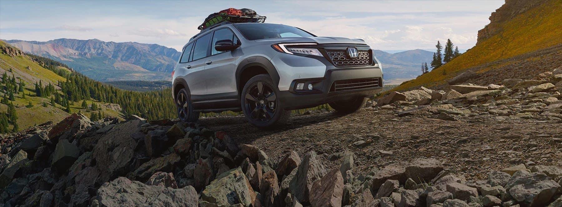 Honda driving through mountains