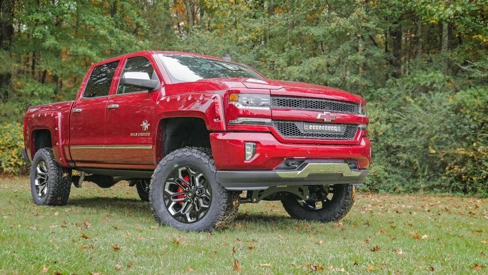 red chevy lifted truck