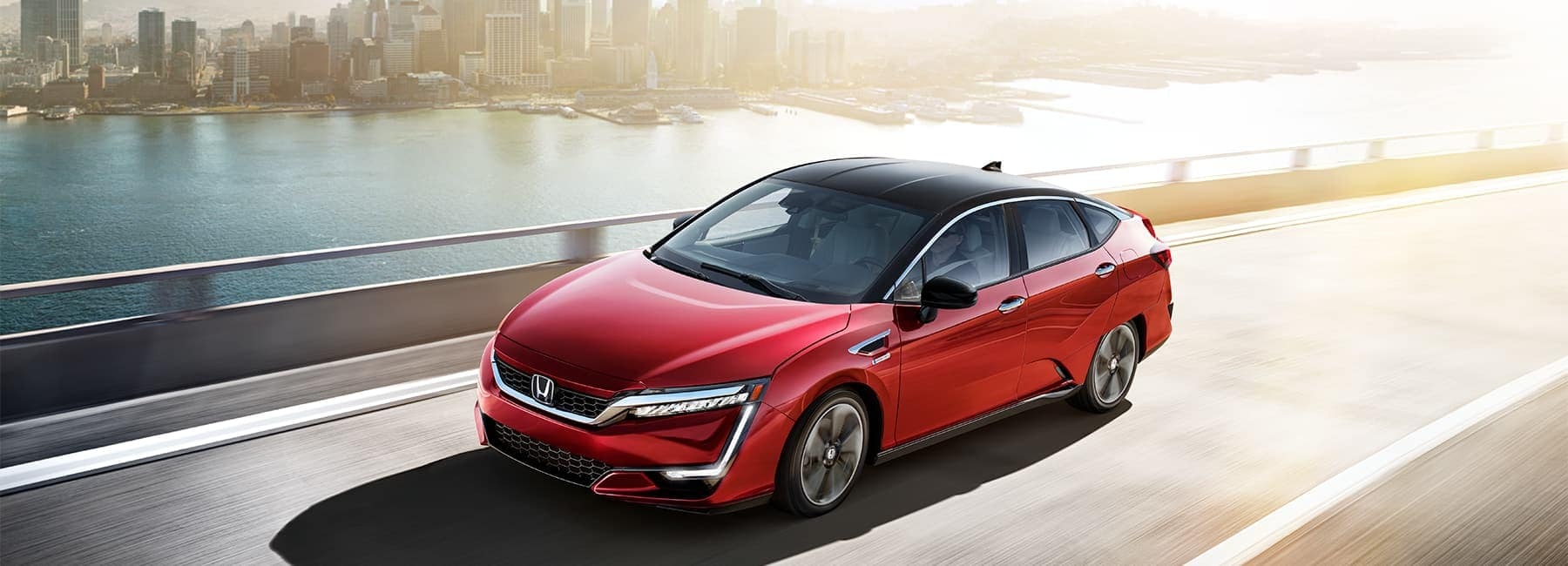 2020-honda-clarity-driving-city-background