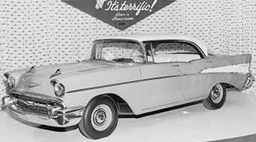 Showroom window display of the new 1957 Chevrolet, the car that would become the icon of an era.