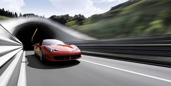blurred ferrari coming out of a tunnel
