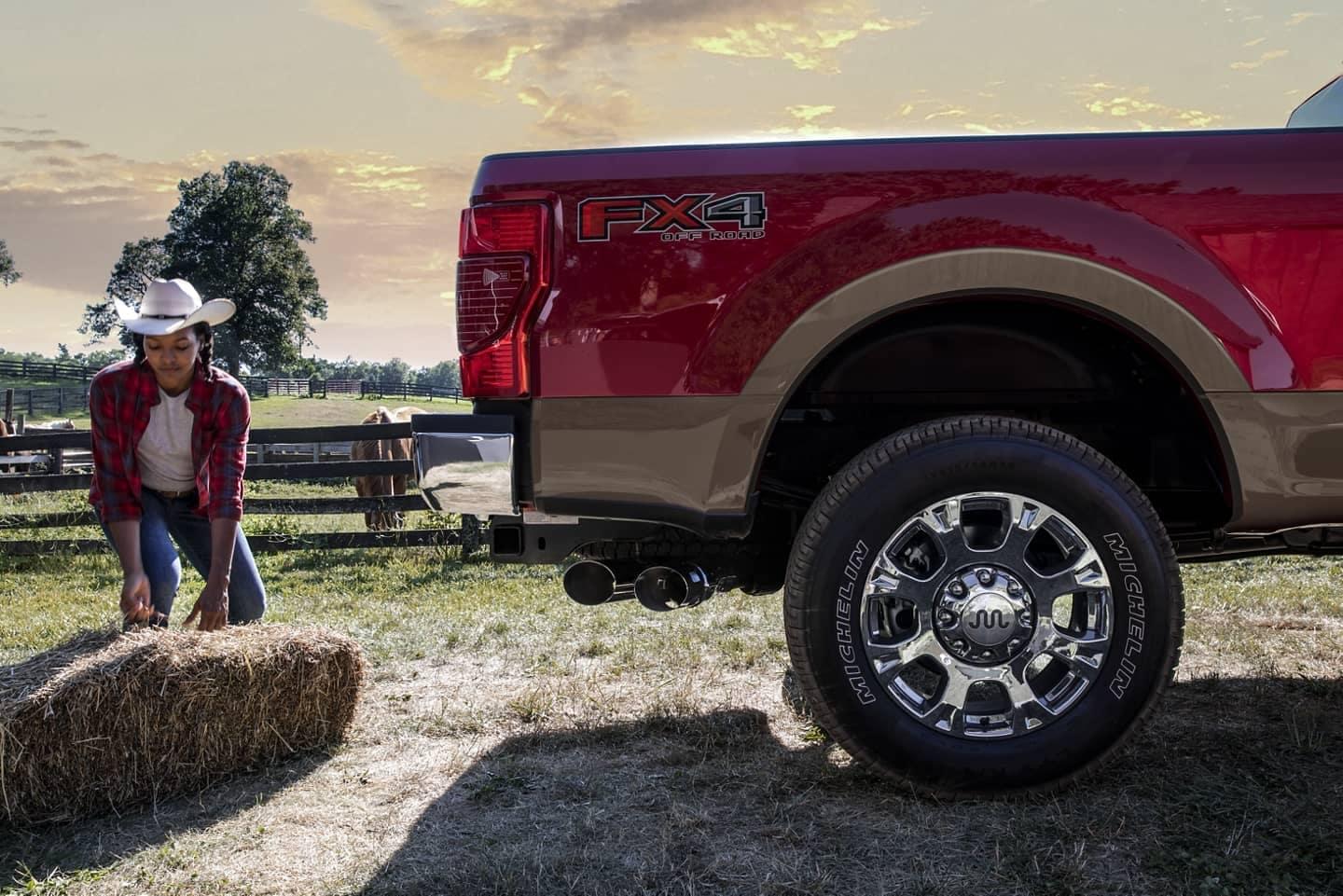 loading hay into a Ford Super Duty truck