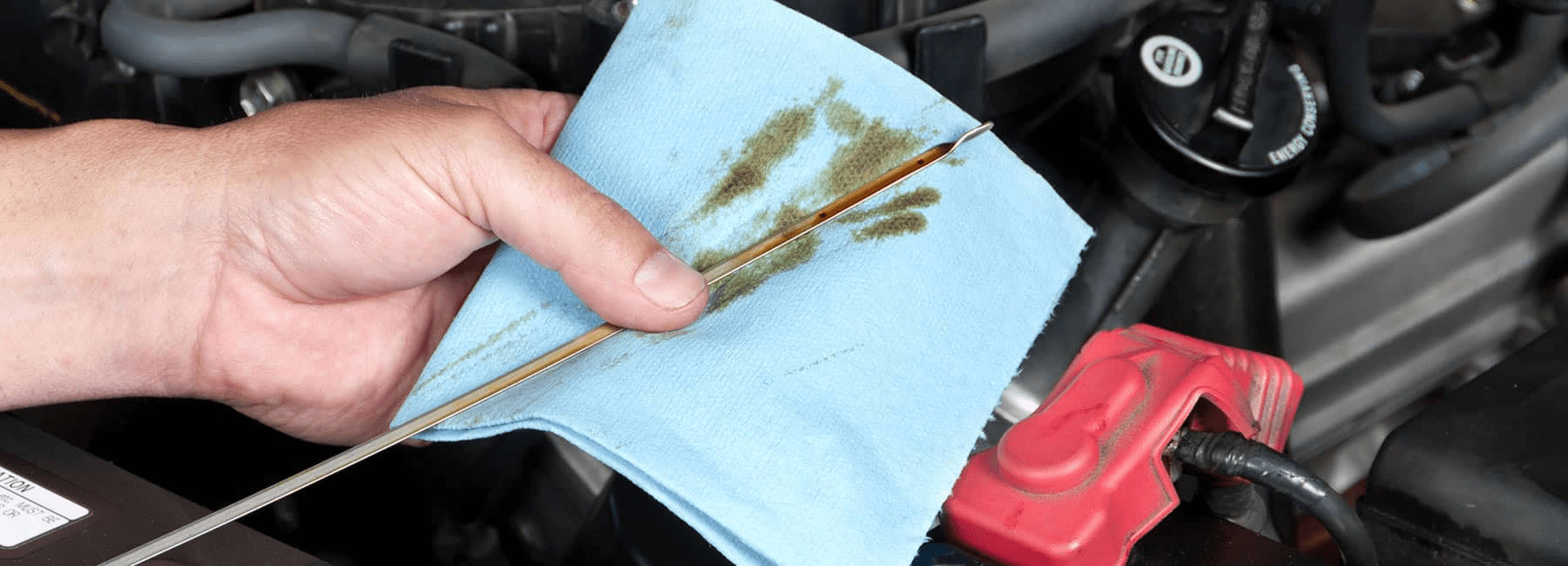 technician cleaning oil dipstick
