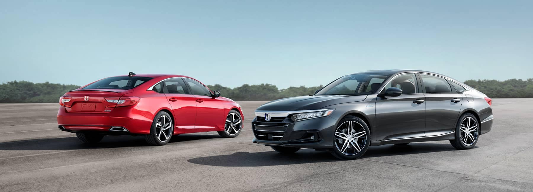A Red and Grey 2021 Honda Accord parked next to each other