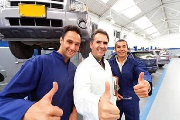Three Mechanics giving the thumbs up