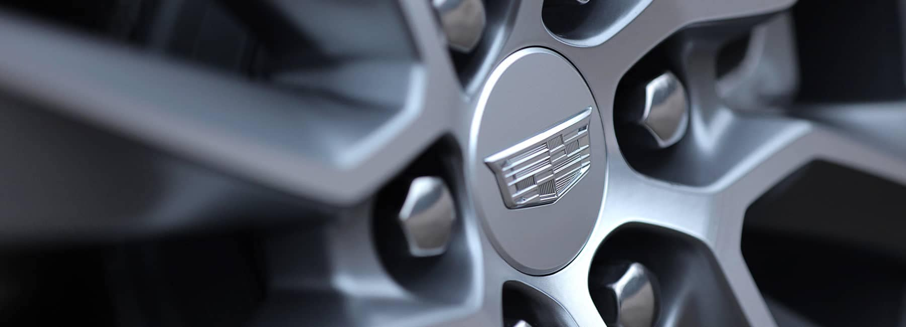 2020 Cadillac Hubcap With Cadillac Emblem on it