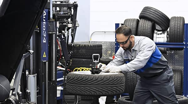 MB technician working on a tire