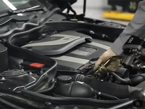 Service Technician Inspecting Car