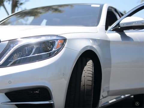 White Mercedes-Benz with door open