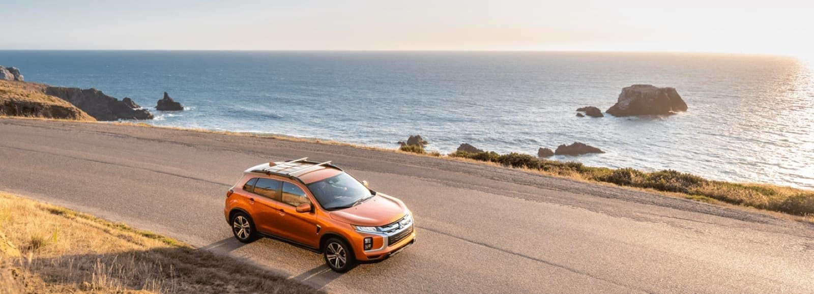 orange outlander on the beach