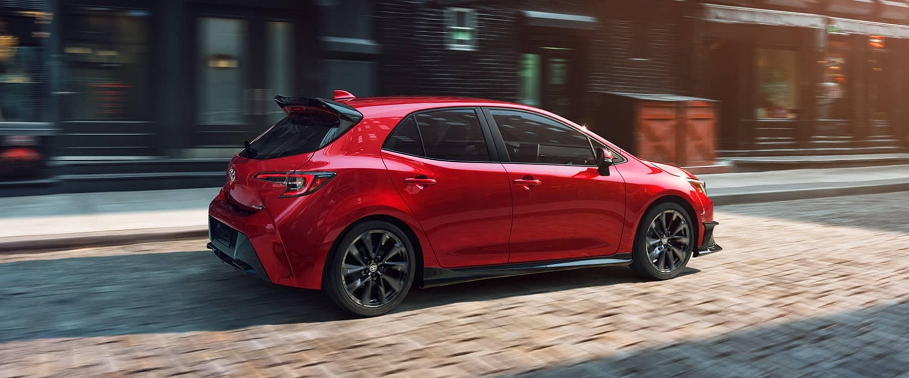 2021 Toyota Corolla Hatchback driving down brick road