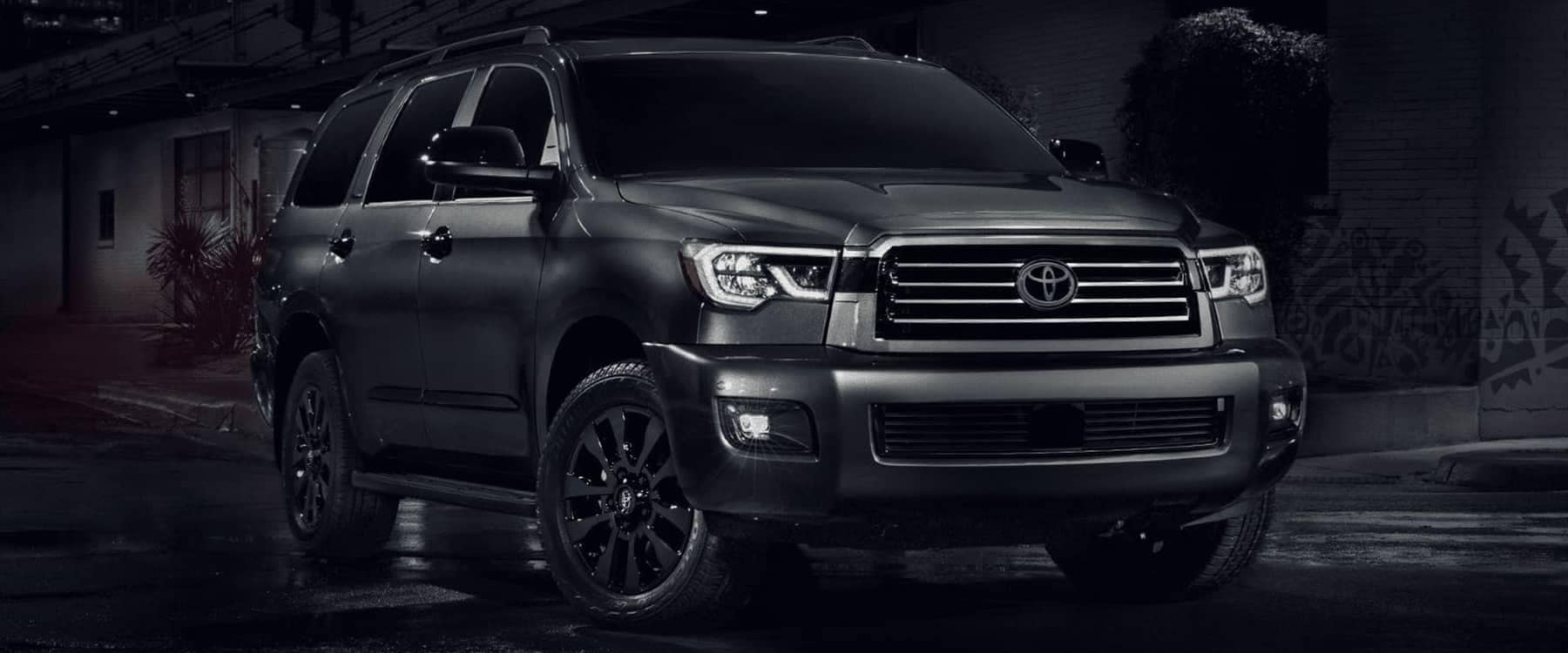 2021 Toyota Sequoia parked in street at night
