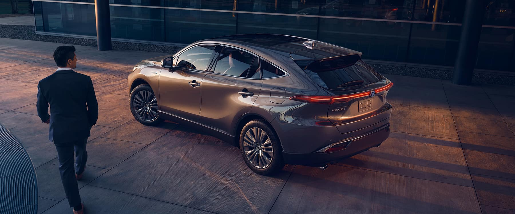 2021 Toyota Venza parked on side with man walking by
