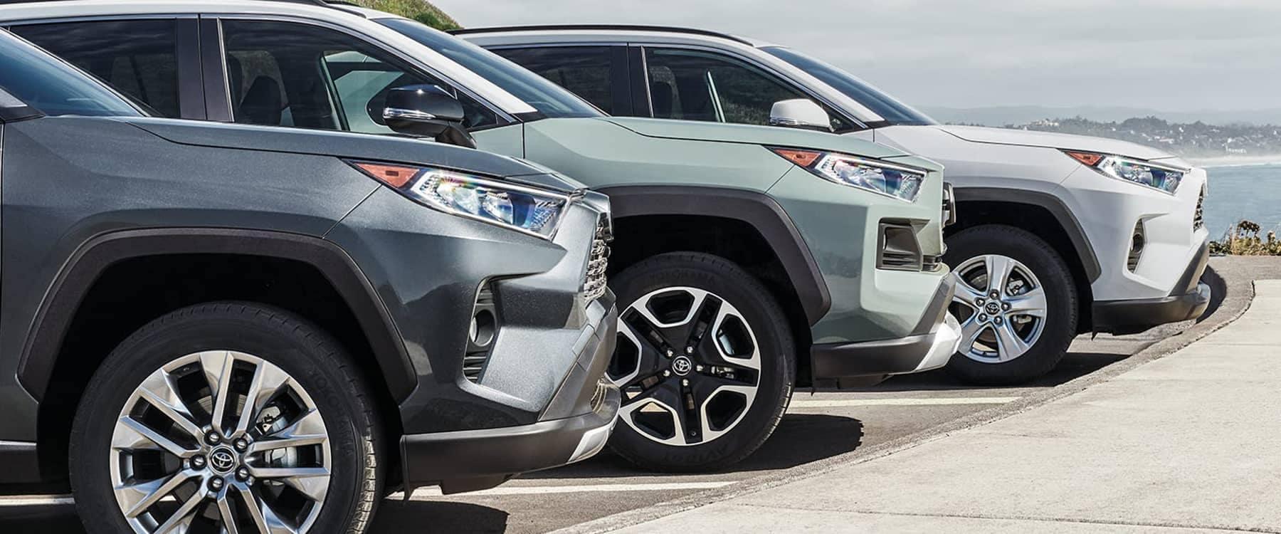 Three 2021 Toyota RAV4s parked