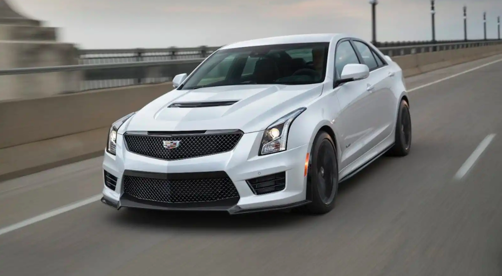 A white 2018 Cadillac ATS V on a test drive over a bridge near Fort Worth