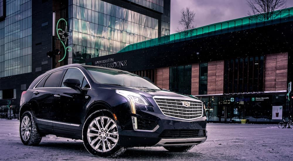 A black 2018 Cadillac XT5 in front of a university