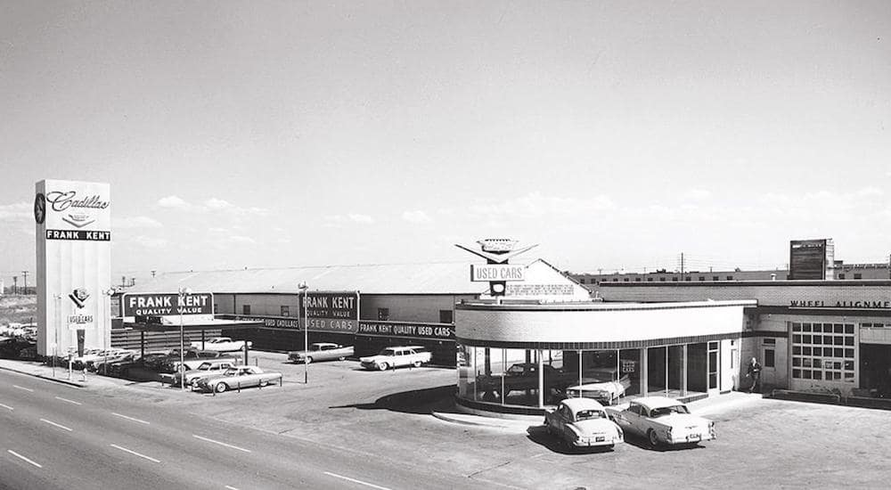 A black and white photo of the original Frank Kent Cadillac dealership