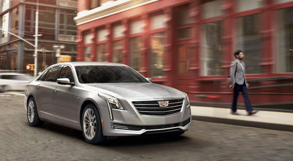 A silver Cadillac CT6 on a paver street