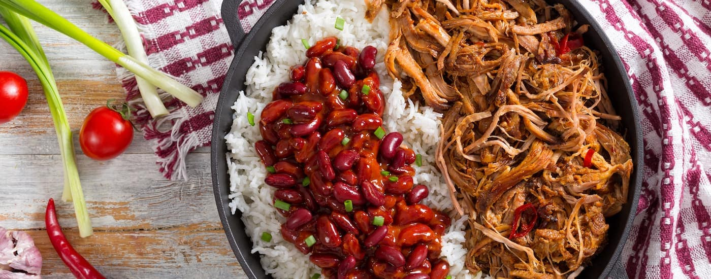 A plate of pulled pork is shown, which is a great option for lunch when shopping for a used Cadillac in Dallas.