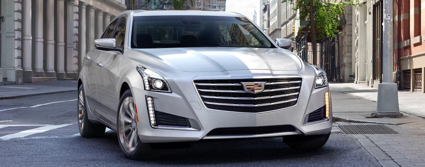 A silver 2019 Cadillac CTS on a city street after leaving a Cadillac dealer near me