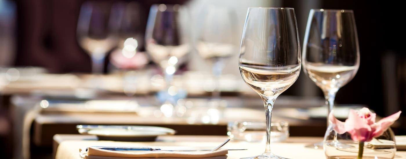 Tables are set up at a fine dining restaurant near a Cadillac dealer near you