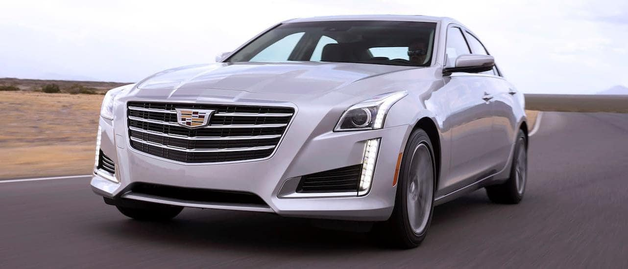 A used Cadillac CTS driving on a track near Dallas