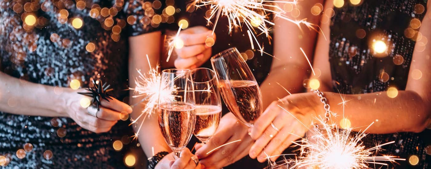 Friends are clinking champagne glasses at a New Years Eve party in Dallas, TX.