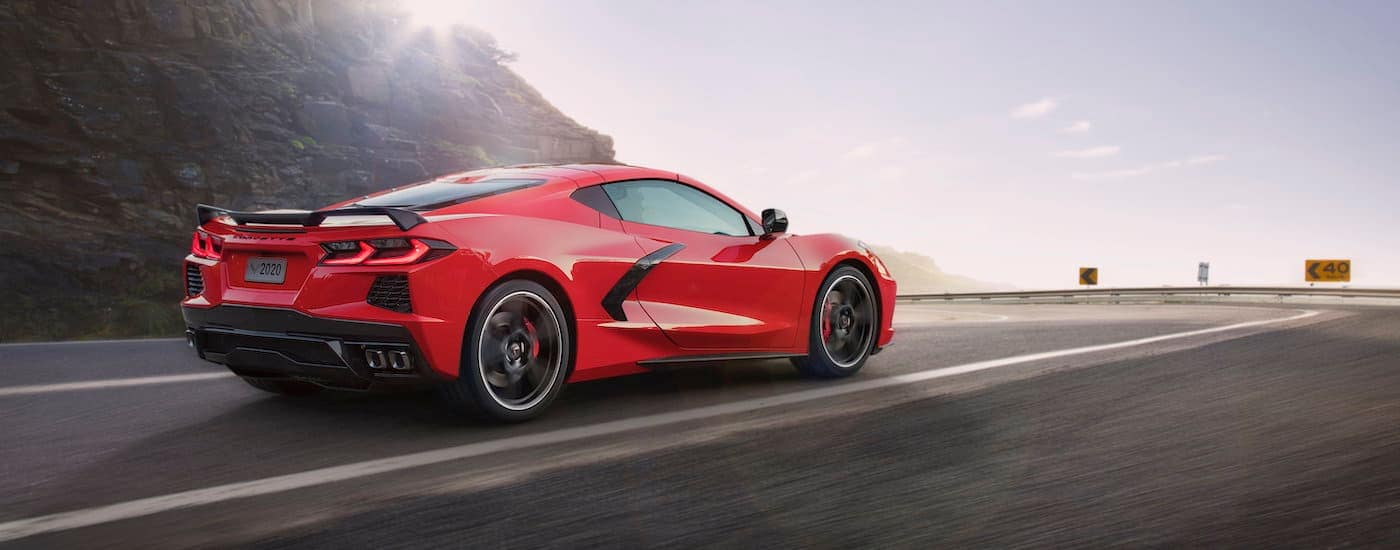 A red 2020 Chevy Corvette is heading towards a corner after leaving a Chevy dealership near Fort Worth, TX.